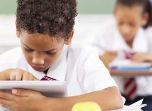 Child with iPad in classroom