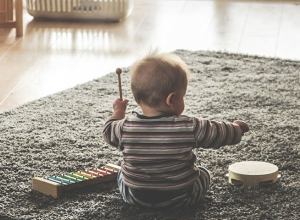 Infant playing at home