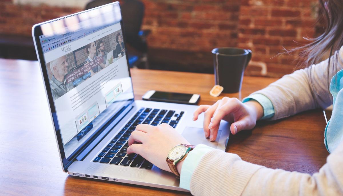 Female behind laptop viso in screen ux