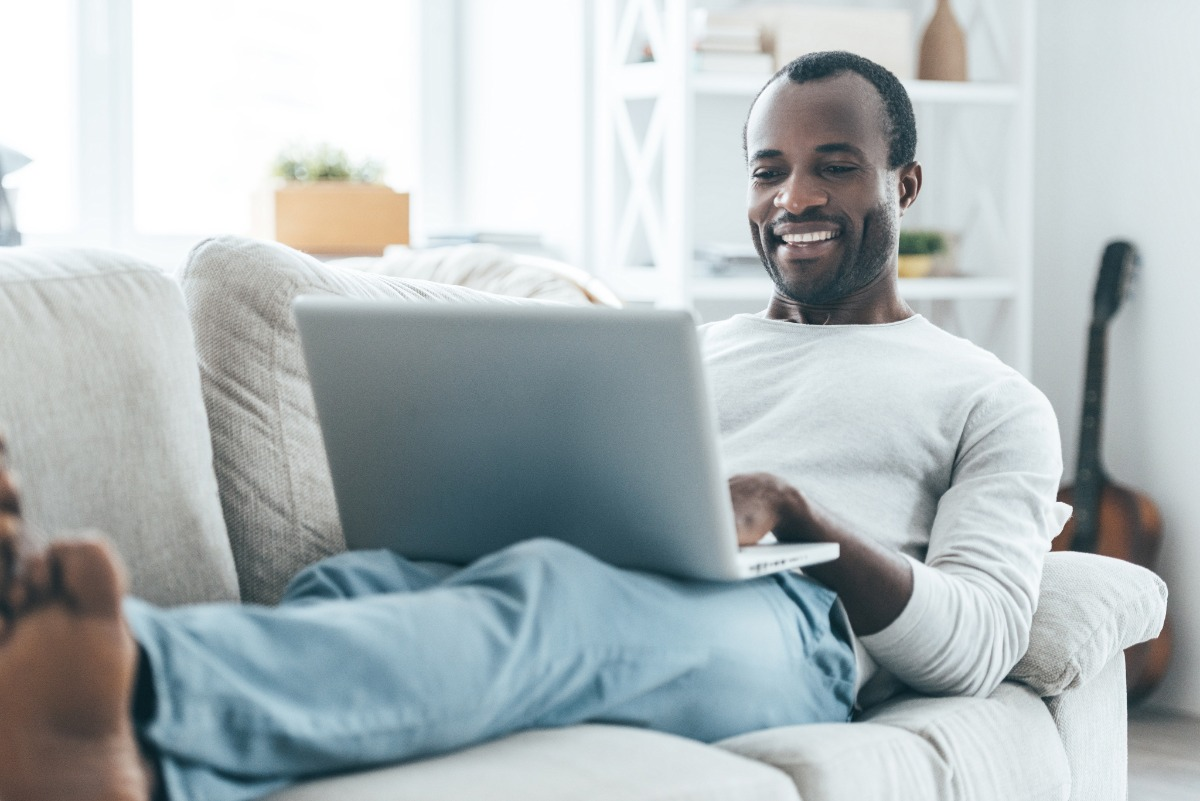man on a sofa with laptop