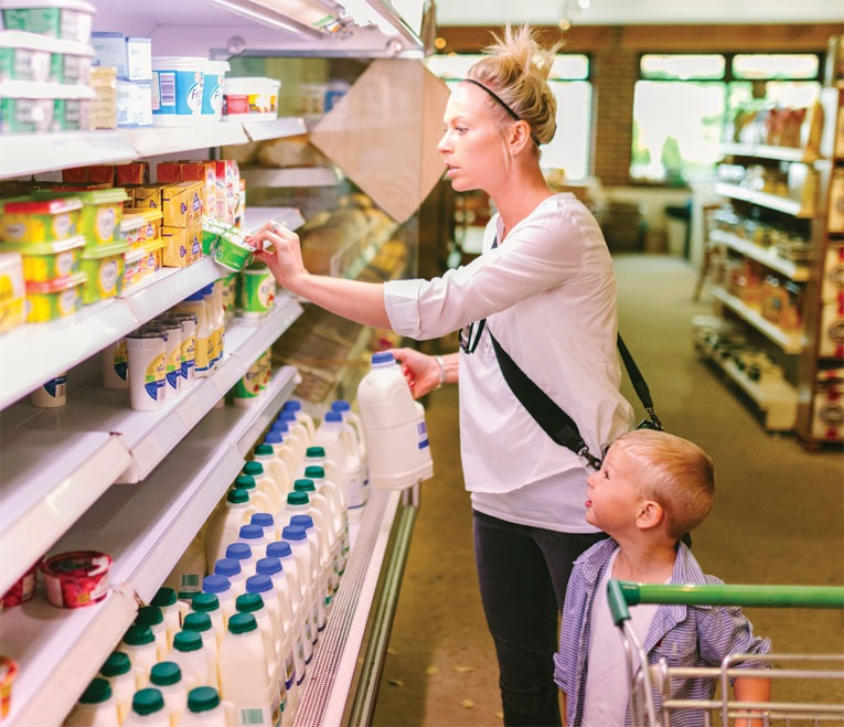 Supermarket consumer behavior woman female child boy milk dairy