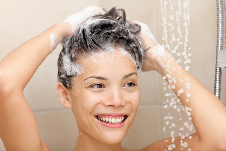 woman in shower washing hair shampoo