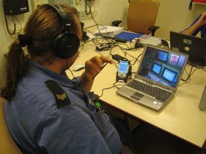 TNO Navy man behind desk laptop headphones