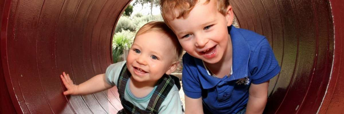 How do children interact with their older autistic siblings?
